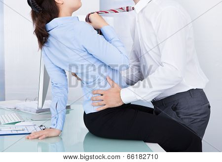 Businesswoman And Businessman Flirting