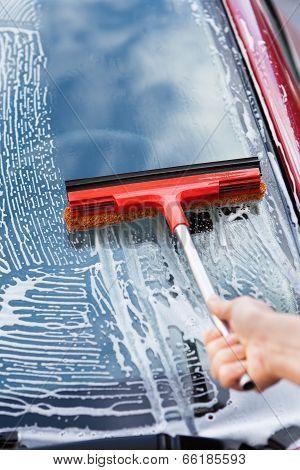 Hand Washing Car Window With Mop