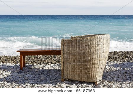 Wicker Chair And Wooden Table
