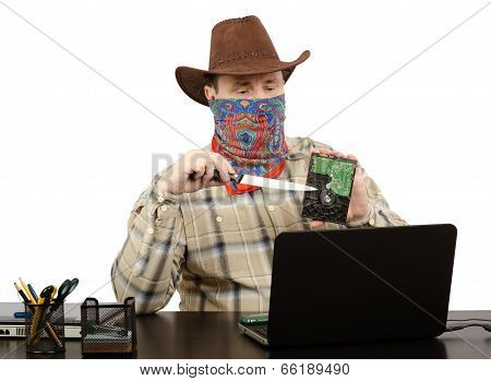 Cowboy Holding A Knife And Hard Disk Threats On Skype