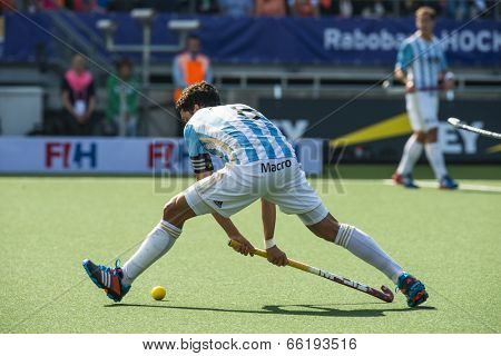 THE HAGUE, NETHERLANDS - JUNE 1: Argentinian player Rey is about tho play the ball during the Hockey World Cup 2014 in the match between The Netherlands and Argentina (men). NED beats ARG 3-0