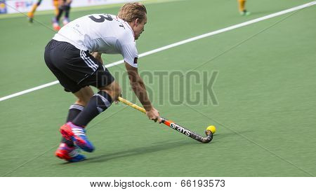 THE HAGUE, NETHERLANDS - JUNE 1: German player Butt is playing the ball during the Hockey World Cup 2014 in the match between Germany and South Africa. GER beats RSA  4-0