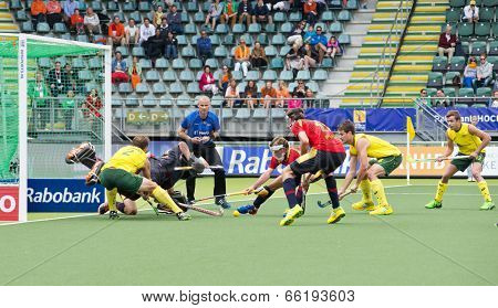 THE HAGUE, NETHERLANDS - JUNE 2: Chaos reigns as Spain vigorously defends a penalty corner by Australia during the World Cup Hockey,