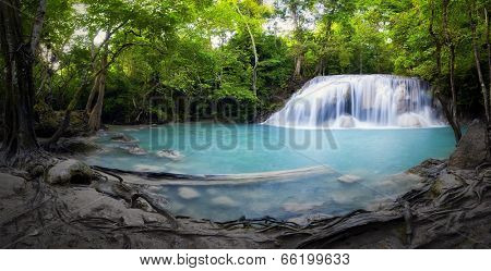 Panorama of tropical forest, waterfall and small pond in Thailand. Scenic nature background