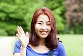 pic of mongolian  - Smiling mongolian girl in a park horizontal - JPG