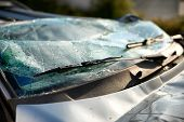 pic of wiper  - Close up of the shattered windscreen and wipers of a car that has been involved in an accident - JPG