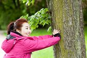 stock photo of mongolian  - Mongolian woman training with a tree horizontal - JPG