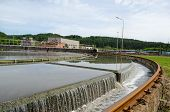 foto of waste reduction  - Primary sewage waste water filtration sedimentation step in treatment facility equipment - JPG