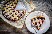 foto of cherry pie  - Open Cherry Pie On The Wooden Background - JPG