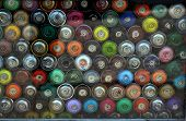 stock photo of graffiti  - A lot of colorful Graffiti Aerosol Spray cans - JPG