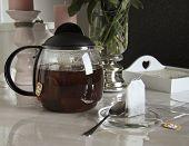 picture of pompous  - glass teapot on the table tea break - JPG