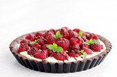 stock photo of tarts  - tart with raspberries and chocolate  - JPG
