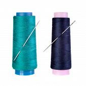 stock photo of jade blue  - Jade color and dark blue thread spools with a needle on a white - JPG