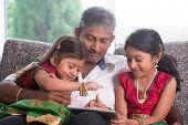 stock photo of indian sari  - Indian family at home - JPG