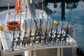 pic of fishing rod  - Fishing rods arranged on a boat in Brighton marina England UK - JPG