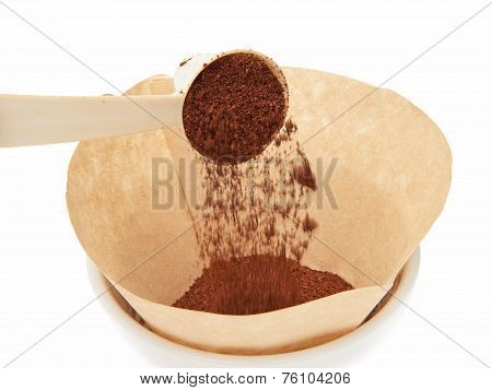 Scooping Grinded Coffee In A Filter