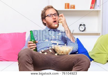 Man With Popcorn And Beer On The Sofa