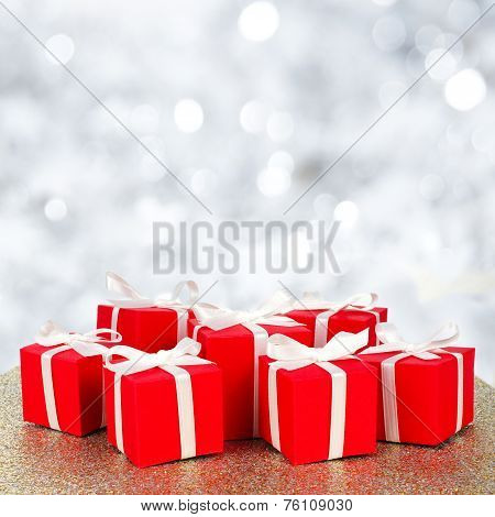 Christmas gift boxes with twinkling background