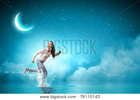 Young scared woman running at night under moon light