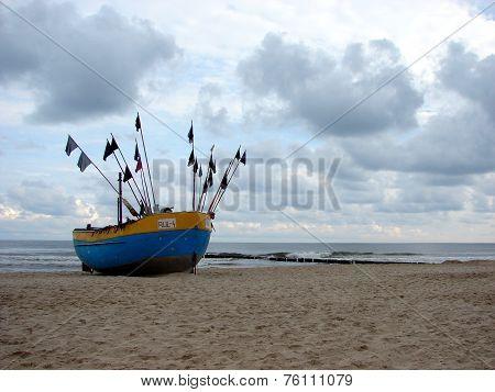 Fishing boat on the Balitc sea shore