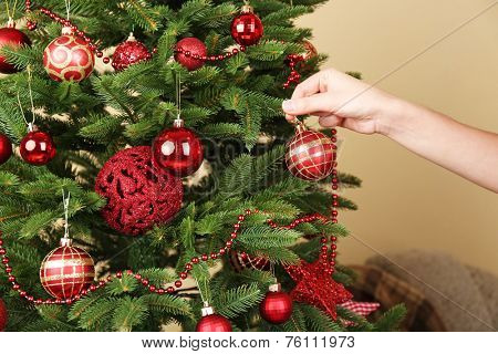 Decorating Christmas tree close-up
