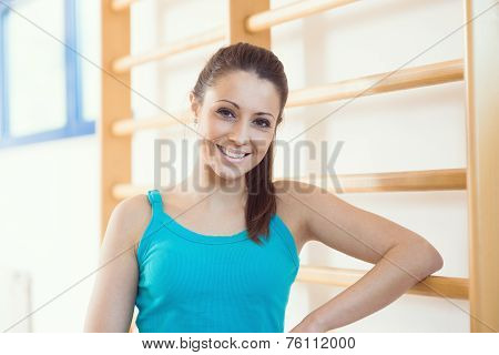 Attractive Smiling Woman At Gym