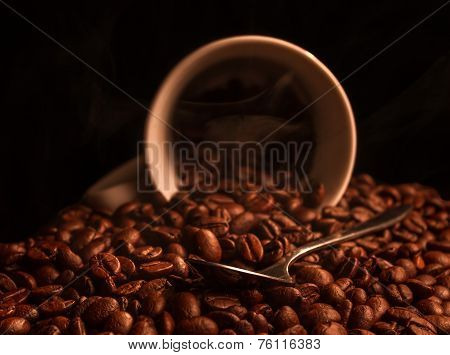 Cup with roasted coffee beans