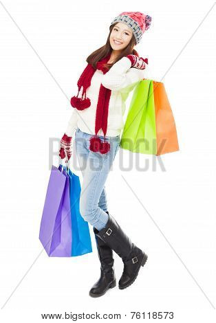 Beautiful Happy Young Woman Holding Shopping Bags