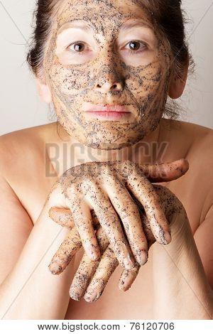 Mature woman making cosmetic mask