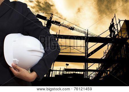 Engineer Holding White Helmet