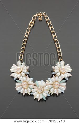 plastic necklace. five beige flower