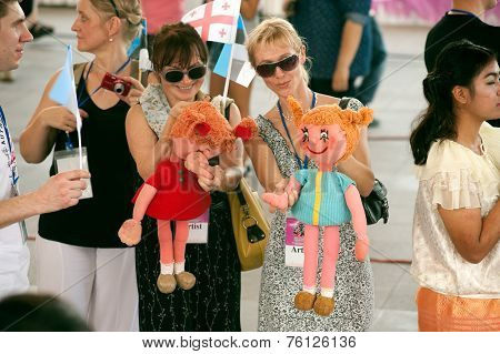 Actors Holding Puppets In Harmony World Puppet Carnival In Bangkok,Thailand 2014 Parade.