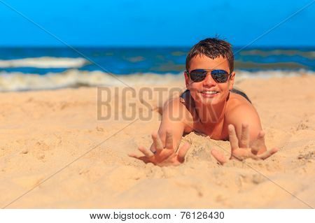 Happy Young Boy On The Sea Beach