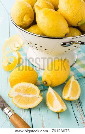 Fresh lemons in retro colander.