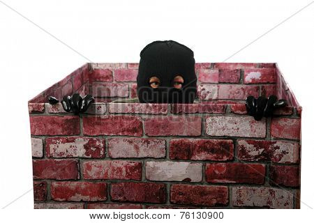 A genuine Bad Guy aka Burglar pops his head out of a chimney looking to see if the coast is clear for his escape after robbing money and valuables from a persons home. Burglars are cowardly thief's