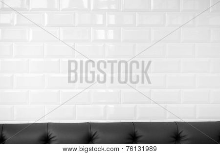 White Ceramic Brick Tile Wall With Leather Sofa