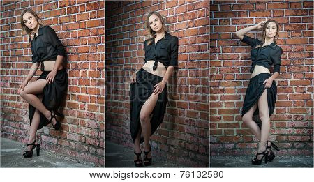 Charming young brunette woman in black on high heels near a red brick wall