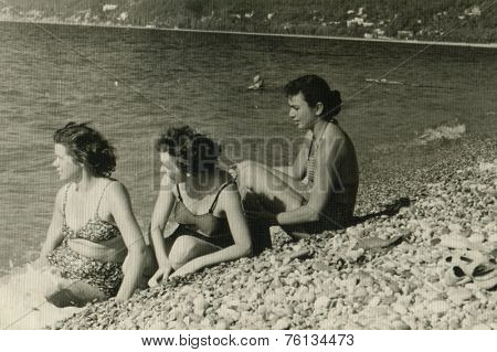 RUSSIA - CIRCA 1960s :  Vintage photo shows  Soviet girls resting on the beach.