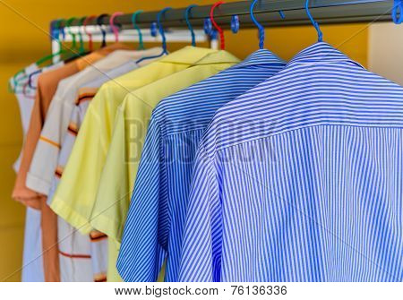 Blue Shirt With White Stripes Wait For Dry During
