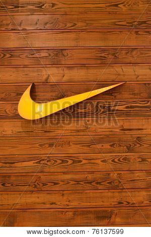 HONG KONG - APRIL 02: Nike, Inc. logo on wooden wall on April 02, 2014 in Hong Kong. The company was founded on January 25, 1964, as Blue Ribbon Sports, by Bill Bowerman and Phil Knight