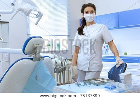 Portrait Of Woman Dentist At Her Office