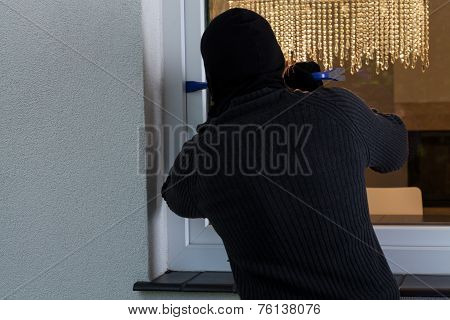 Man Breaking Into The House