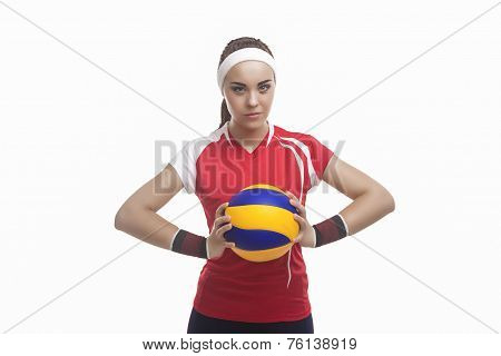 Portrait Of Strong Willed Caucasian Professional Female Volleyball Player Equipped In Volleyball Out