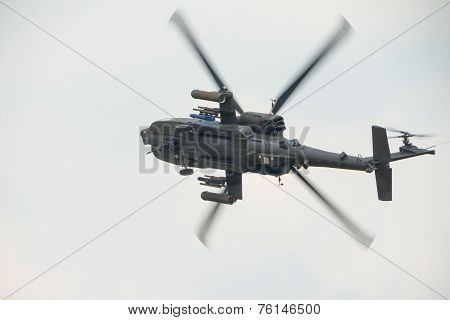 An Raf Apache Attack Helicopter In Flight
