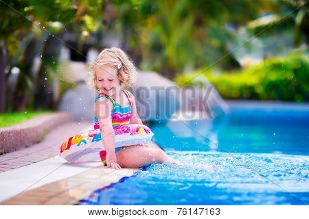 Happy Little Girl In A Swimming Pool