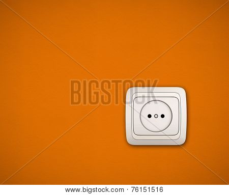 Simple White Electric Socket On Orange Wall
