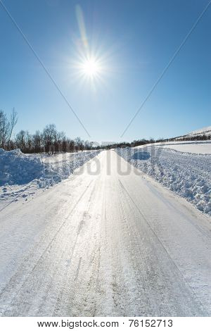 Extremely Slippery Winter Road On A Sunny Day