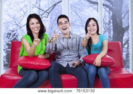 Group Of Cheerful Teenager On Sofa