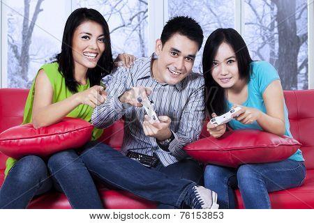 Hispanic Teenager Playing Video Game