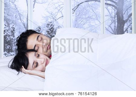 Lovely Couple Sleeping On Bed